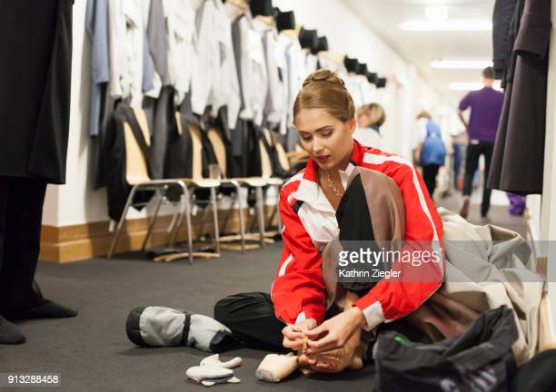 Backstage with the Bavarian State Ballet: Dancer preparing her feet to put on pointe shoes