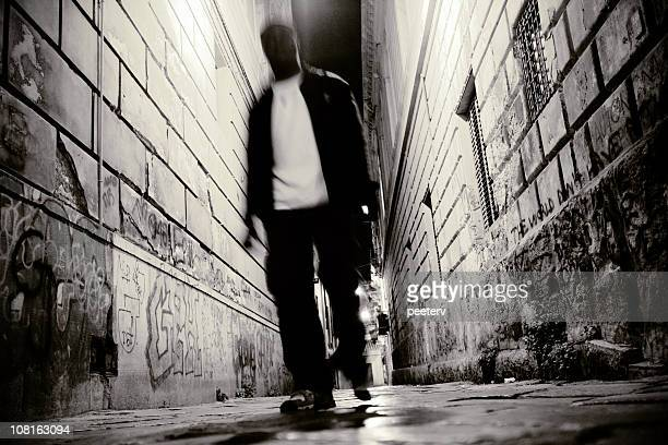 backstreet walk - black alley stock photos and pictures