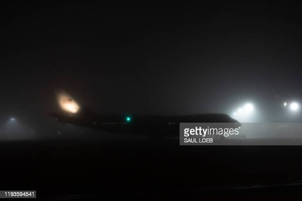 A backup Boeing VC25A that serves as Air Force One is seen on the tarmac in heavy fog prior to departing from Louis Armstrong New Orleans...