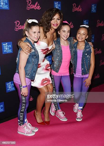 A backup dancer actress and singer Zendaya dancer Kaycee Rice and a backup dancer attend the Barbie Rock 'N Royals Concert Experience at the...