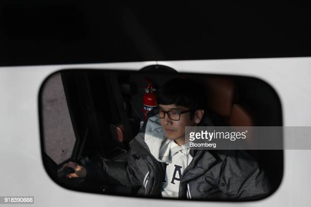 A backup driver is reflected in a mirror of an autonomous 5G connected bus operated by KT Corp during a media event in Gangneung Gangwon Province...