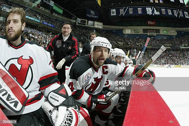 Backup goalie Corey Schwab and Scott Stevens of the New Jersey Devils watch  from the bench fb9a1cf45