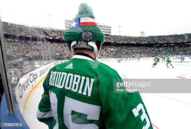Backup goaltender Anton Khudobin of the Dallas Stars looks on from the corner ice boards during warmup prior to the 2020 NHL Winter Classic between...