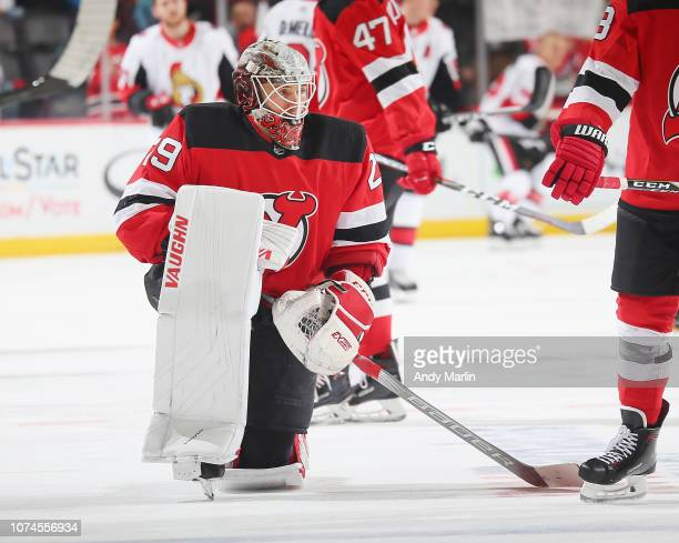 Backup goaltender Mackenzie Blackwood of the New Jersey Devils stretches during warmups prior to the game against the Ottawa Senators at Prudential...