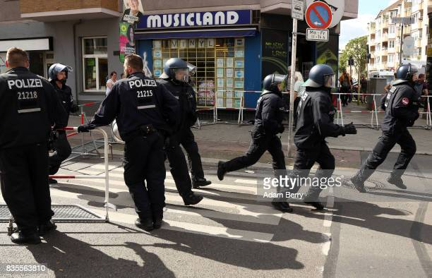 Backup police officers arrive as NeoNazis march at an extreme rightwing demonstration commemorating the 30th anniversary of the death of Nazi leader...