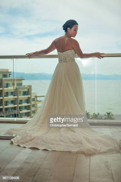 backview of bride on balcony - prom dress stock pictures, royalty-free photos & images