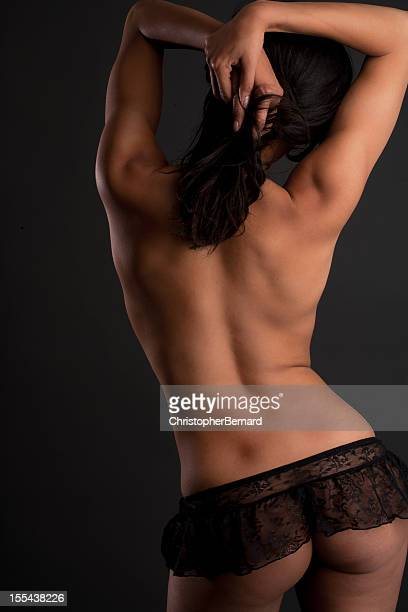 backview of topless model - bare bottom women stock photos and pictures
