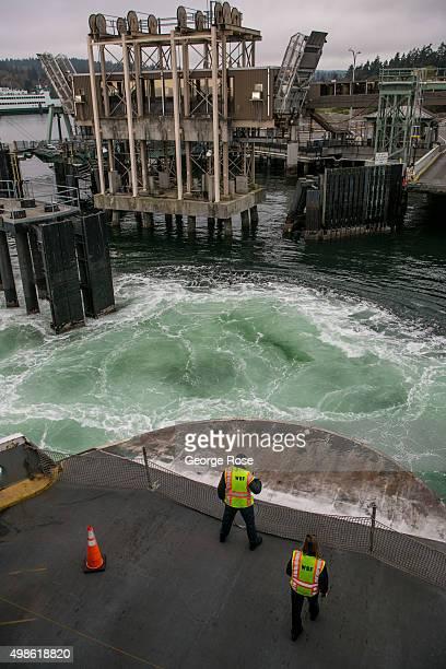 Backwash from the Bainbridge Island Ferry as it pulls into the terminal is viewed on November 4 in Bainbridge Island Washington Seattle located in...