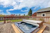 Backyard deck with hot tub