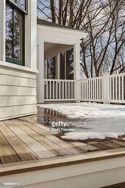 Backyard deck with snow