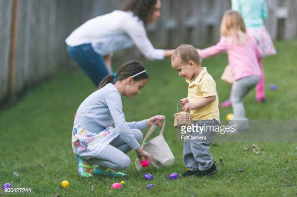 backyard easter egg hunt! - easter egg hunt stock photos and pictures