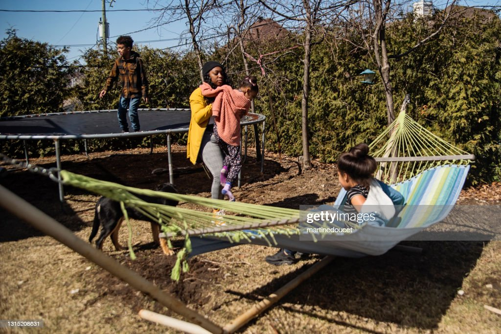 Backyard hangout for mixed-race family in springtime. : Stock Photo