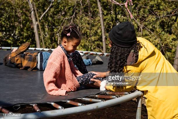 "backyard hangout for mixed-race family in springtime. - ""martine doucet"" or martinedoucet stock pictures, royalty-free photos & images"