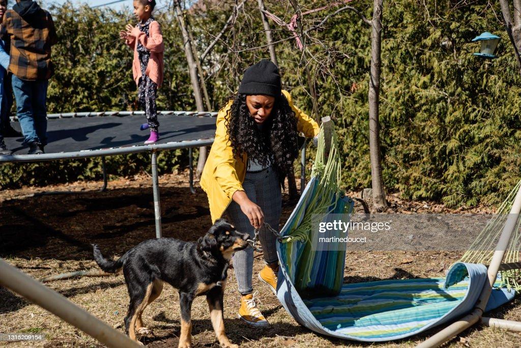 Backyard hangout for mixed-race family in springtime. : Stock Photo
