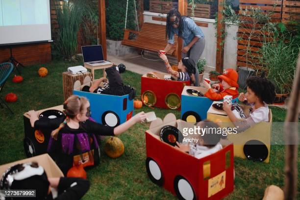 backyard movie night - scaredastronaut stock pictures, royalty-free photos & images