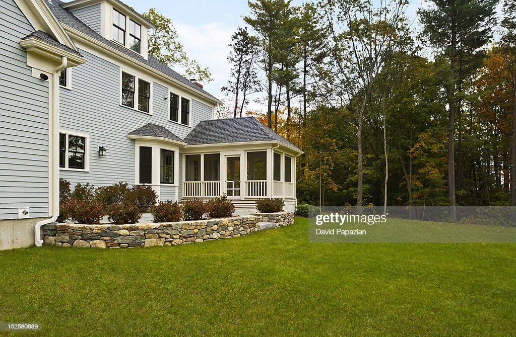 Backyard of two story home. : Stock Photo
