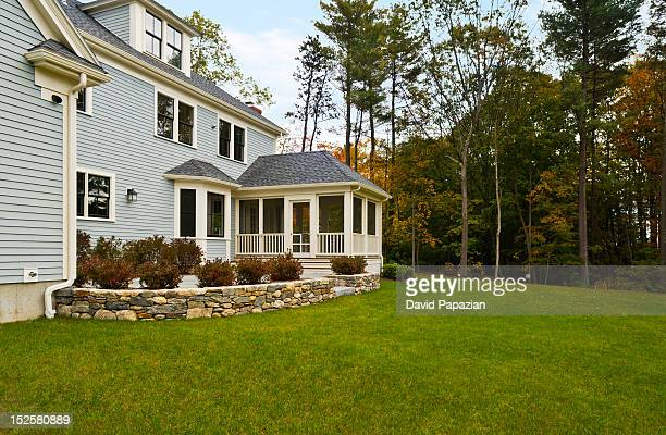 backyard of two story home. - courtyard stock pictures, royalty-free photos & images
