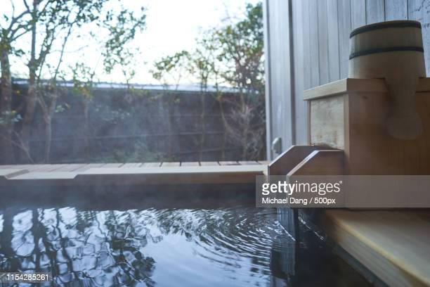 backyard onsen - hot spring stock pictures, royalty-free photos & images