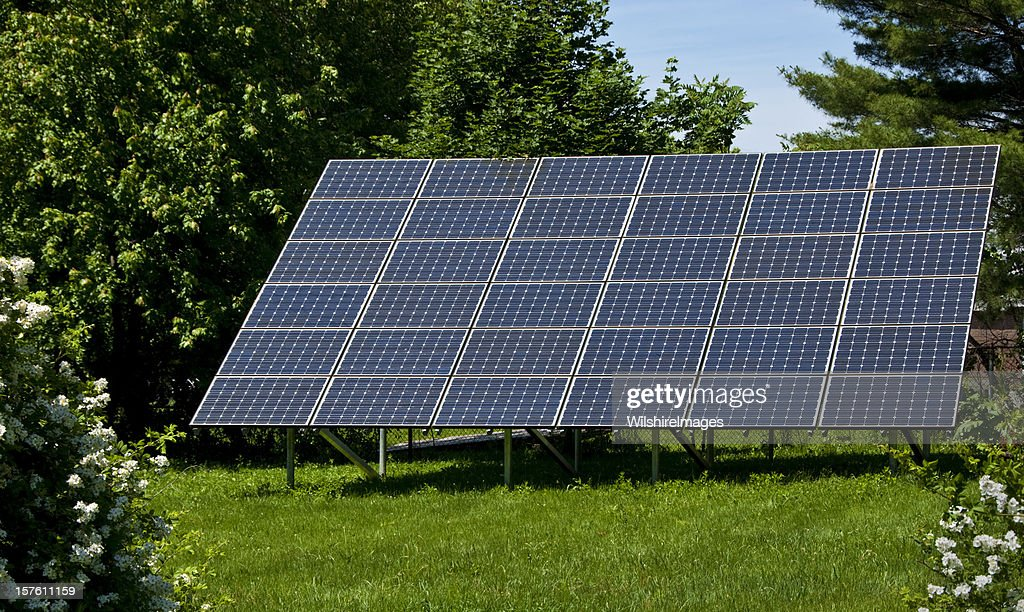 Backyard Solar Panels Generate Electricity Cutting Carbon Foot Print :  Stock Photo