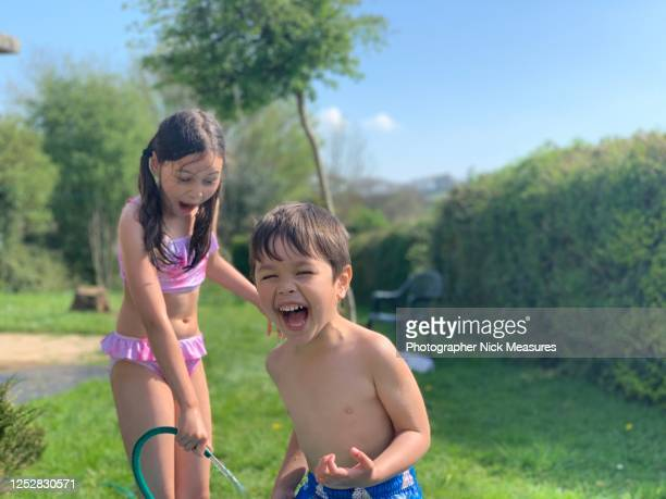 backyard water fun - summer stock pictures, royalty-free photos & images