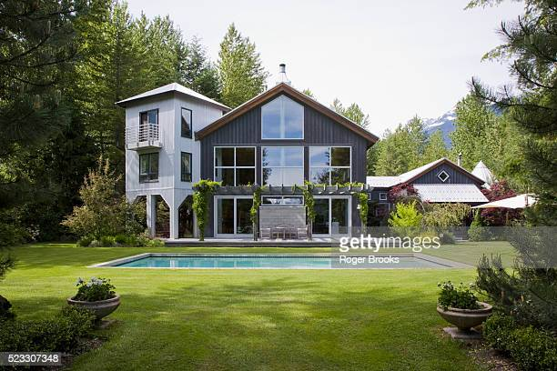 backyard with pool of contemporary house - house stock pictures, royalty-free photos & images