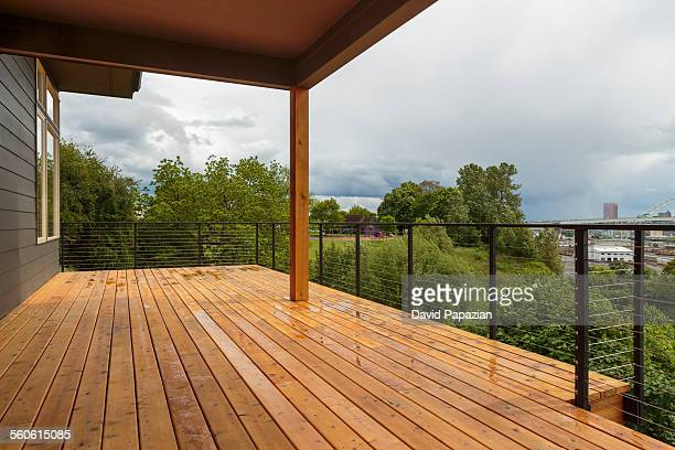 Backyard wooden deck with city view