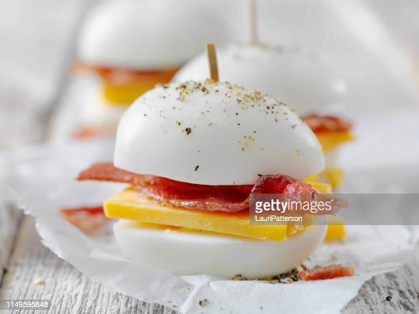 bacon and cheddar hard boiled eggs - cholesterol stock pictures, royalty-free photos & images