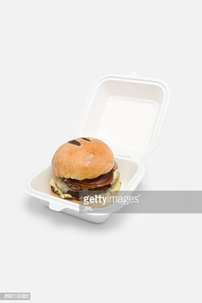 Bacon cheeseburger in takeout box
