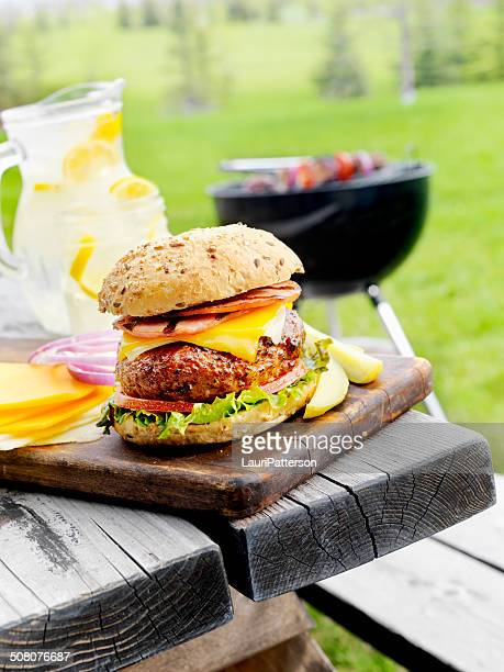 bacon cheeseburger - picnic table stock pictures, royalty-free photos & images