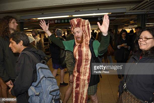 Bacon costumed agent at Union Square Improv Everywhere's 15th annual No Pants Subway Ride New York took place in unseasonably warm temperatures and...