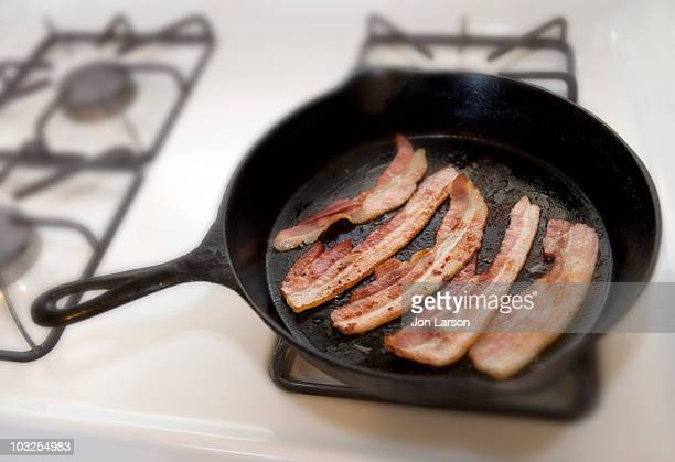 Bacon frying in a cast iron skillet