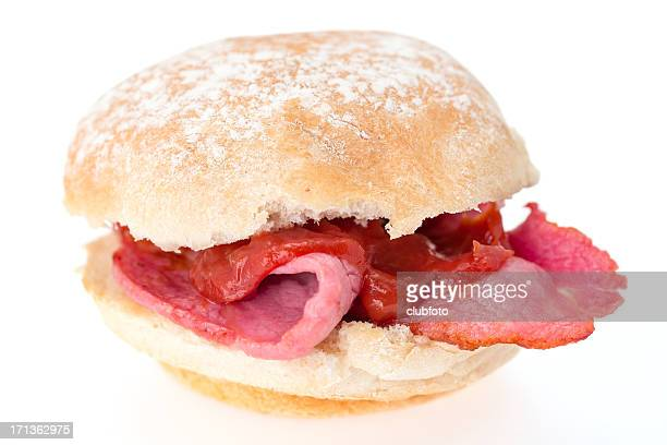bacon roll with tomato ketchup - bun stock pictures, royalty-free photos & images
