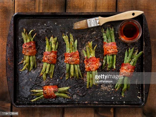 bacon wrapped green beans roasted with a maple glaze, salt and pepper - glazed food stock pictures, royalty-free photos & images