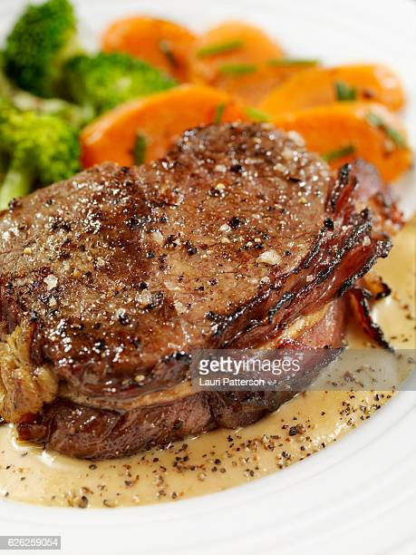 Bacon Wrapped Steak Fillets with a Cream Peppercorn Sauce