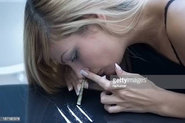 bad addicion snorting drugs - cocaine stock photos and pictures