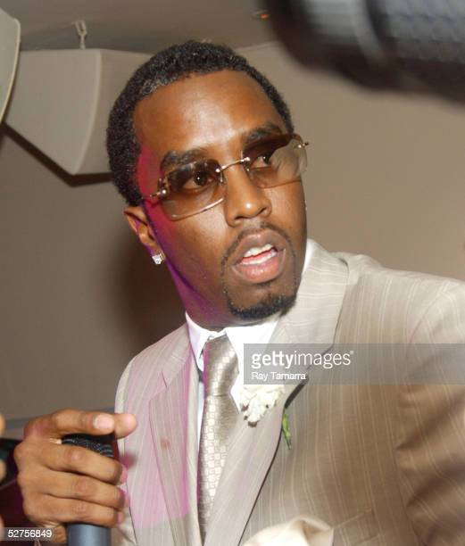 Bad Boy founder Sean P Diddy Combs poses for photos at the Bad Boy and Warner Bros Partnership Party at Glow May 03 2005 in New York City