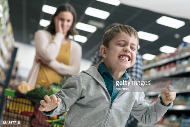 bad boy in supermarket - shouting stock photos and pictures