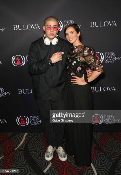Bad Bunny and Bulova brand representative Yuri Ayala attend the gift lounge during the 18th annual Latin Grammy Awards at MGM Grand Garden Arena on...