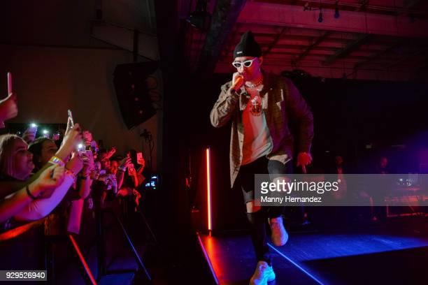Bad Bunny performs on stage at Apple Music Celebrates 'Up Next' Artist Bad Bunny with a concert for fans at Bar 1306 in Miami Florida on March 8 2018