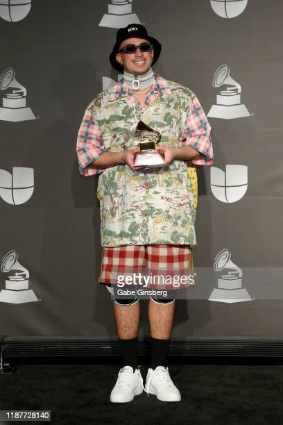 Bad Bunny poses withe the Best Urban Music Album in the press room during the 20th annual Latin GRAMMY Awards at MGM Grand Garden Arena on November...