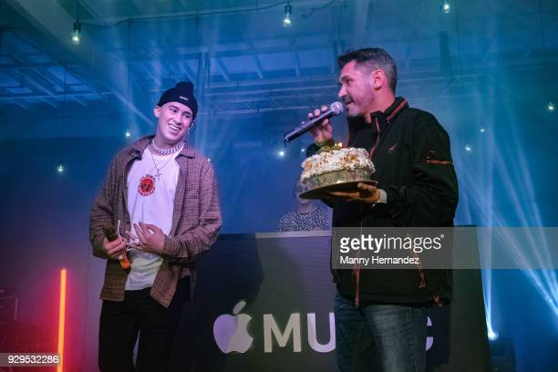 Bad Bunny receives a cake on stage at Apple Music Celebrates 'Up Next' Artist Bad Bunny with a concert for fans at Bar 1306 in Miami Florida on March...