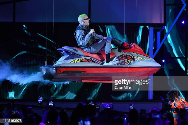 Bad Bunny rides on a personal watercraft above the stage as he performs during the 2019 Billboard Latin Music Awards at the Mandalay Bay Events...