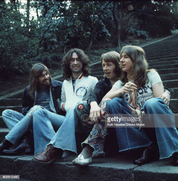 Bad Company group portrait in a park March 1975 Tokyo Japan Paul Rodgers Simon Kirke Mick Ralphs Boz Burrell
