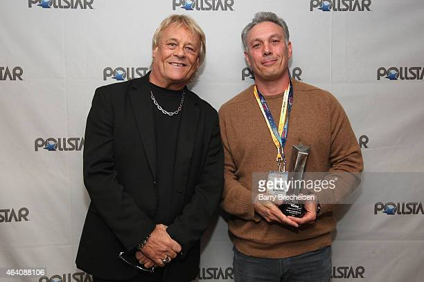 Bad Company's Briane Howe and Comedy Tour of the Year Award recipient Rick Greenstein pose backstage during the 26th Annual PollStar Awards at Ryman...