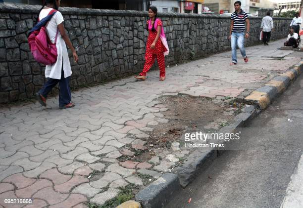 Bad condition of footpath on Dr Annie Besant Road Worli