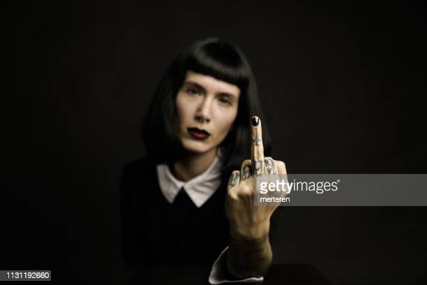 bad girl showing middle finger - anti bullying symbols stock pictures, royalty-free photos & images