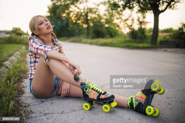 bad girl smoking a cigarette - little girl smoking cigarette stock photos and pictures