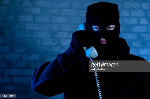 bad guy with mask is on the phone - criminal stock pictures, royalty-free photos & images