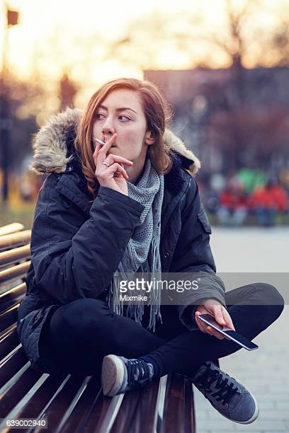 bad habit - little girl smoking cigarette stock photos and pictures