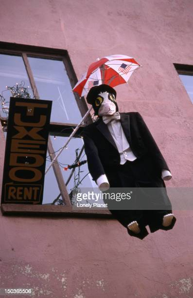 a bad looking penguin in a tuxedo hangs over wisconsin avenue in washington dc. - iron_county,_wisconsin stock pictures, royalty-free photos & images